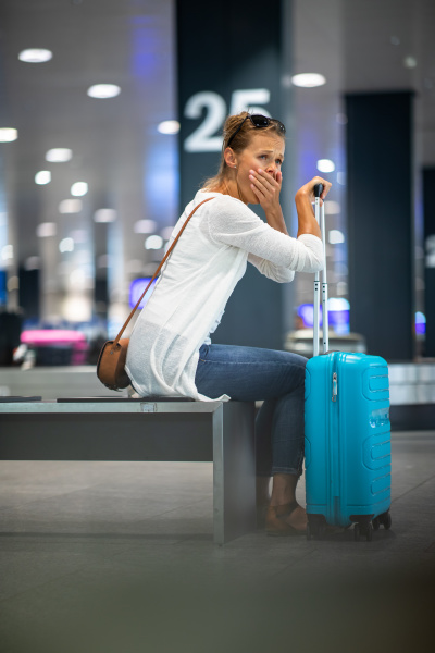 young, woman, with, her, luggage, at - 27968443