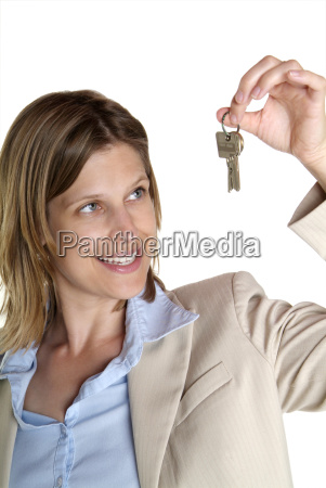 woman showing key