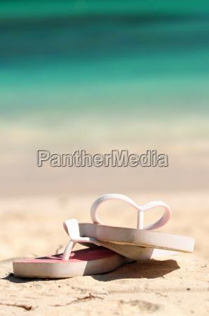 flipflops on a sandy beach