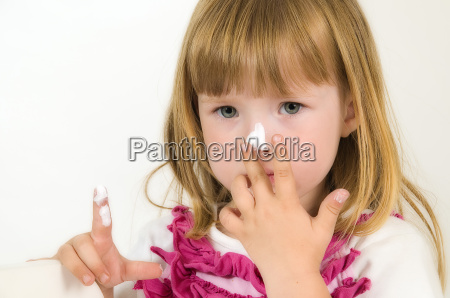 little girl with cream on the