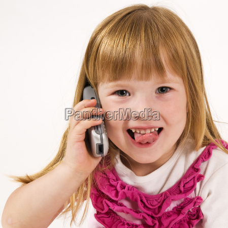 girl with phone showing tongue