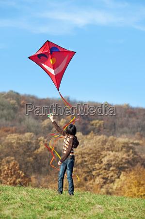 voo do papagaio no outono