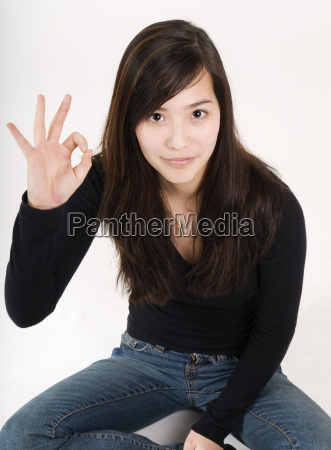 sitting with ok sign