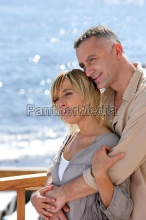 couple, hugging, on, the, sea, terrace - 2914911