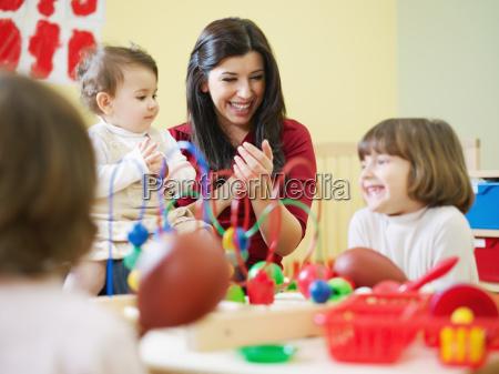 three little girls and female teacher