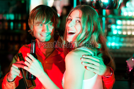 couple drinking in a bar or
