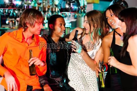 friends in a bar or disco