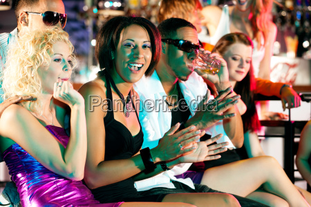 friends dancing in disco or club