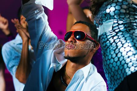 friends dance in disco or club