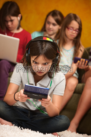 little girl engrossed in gaming