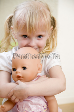 little girl with puppet