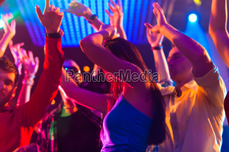 party people dancing in disco or