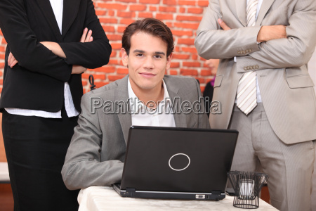 smart young man at a laptop
