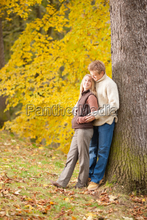 autumn love couple hugging happy in