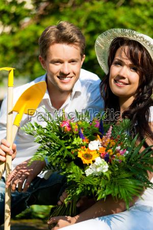 happy couple in the garden in