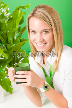 green business office woman smiling plants
