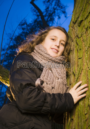 girl by the tree