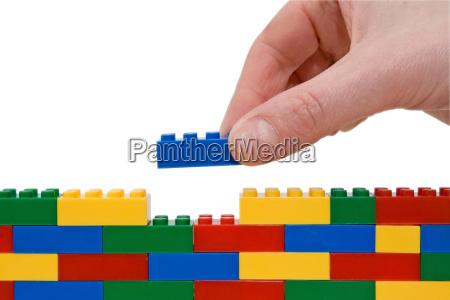 lego da construcao da mao