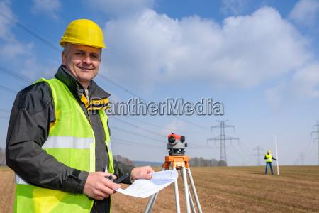 geodesist wear reflective vest measure land