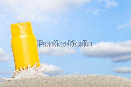 tube with sun protection on beach