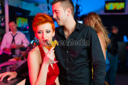 young couple in a bar or