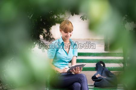 hispanic woman with digital tablet pc