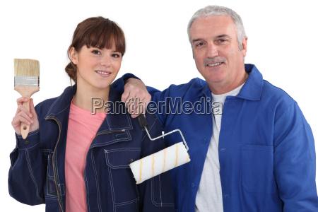 portrait of teenage female apprentice holding