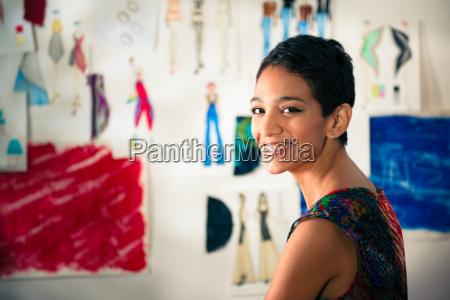 portrait of happy hispanic young woman
