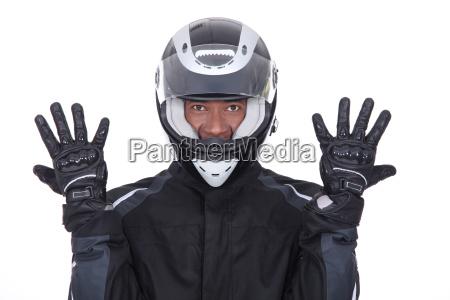 motociclista desgastar pretas casaco luvas capacete
