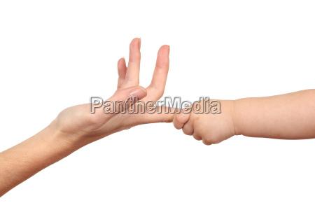 baby hand grabbing a woman finger