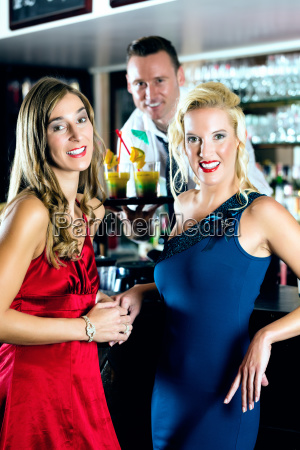women and bartenders in club or