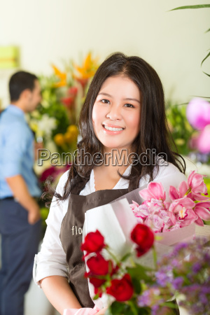 shop assistant and client in flowers