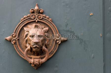 antique door knocker with lion head