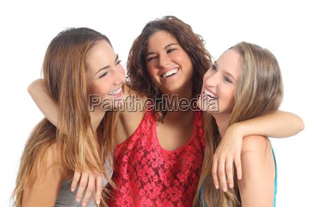 group of three girls hugging happy