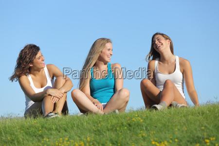 group of three teenager girls laughing