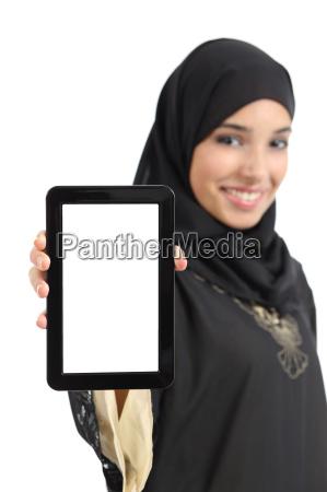 beautiful arab woman showing a blank