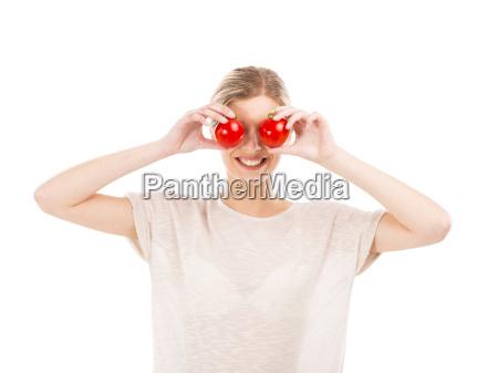 mulher beaitiful com os tomates na