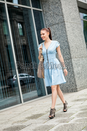 young attractive modern woman with purse