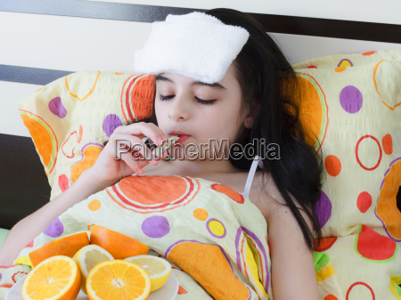 sick young girl in bed with