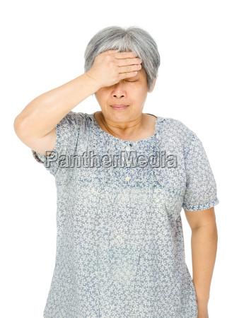 senior asian woman feel sick
