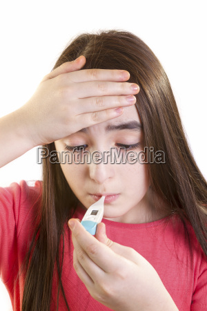 ill girl child with thermometer