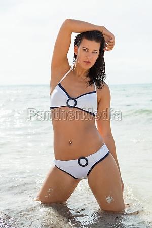 attractive young woman in bikini beach