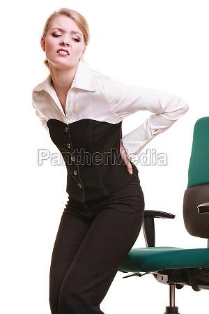 mulher de negocios com dor nas