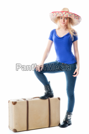 blond girl with suitcases