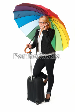 businesswoman with suitcase and umbrella phoned