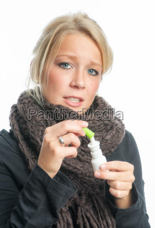 cold woman with sniffle spray