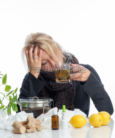 sick blonde woman with remedies