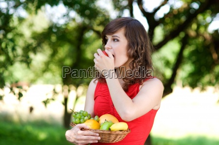 young woman in orchard