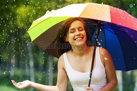 beautiful woman enjoying summer rain