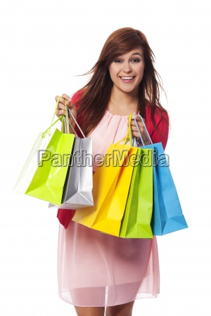 fashionable young woman with shopping bags